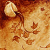 """Angel Sarkela-Saur created this original """"Coffee in the Fall"""" Coffee Art® painting. It features a cup of coffee spilling out images of autumn leaves."""