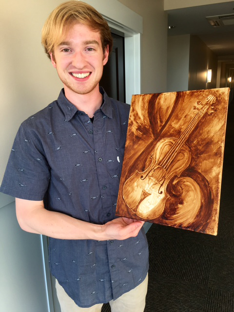 The happy violinist-dentist and his custom Coffee Art painting.